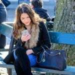 woman with iphone apple lawsuit
