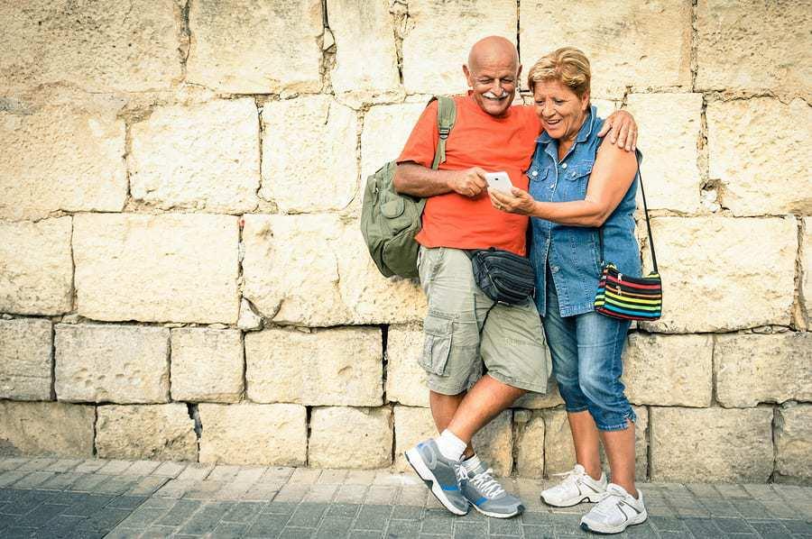 Senior smartphone - mobile travel booking