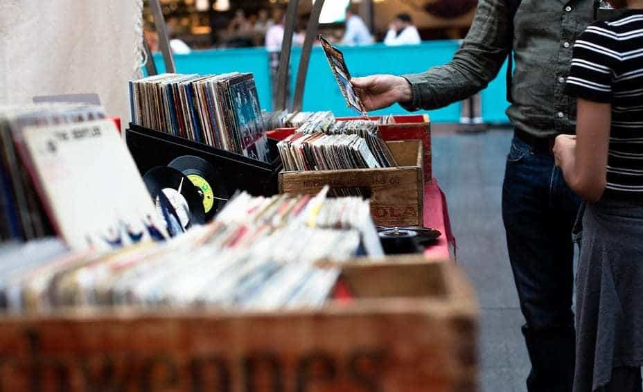 Digital Downloads - Vinyl Sales - People buying records