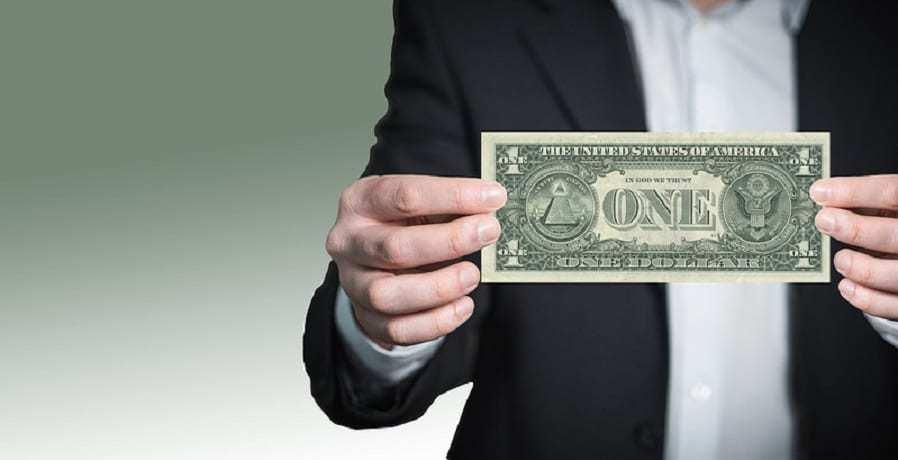Smartphone Sales - Man Holding US Dollar