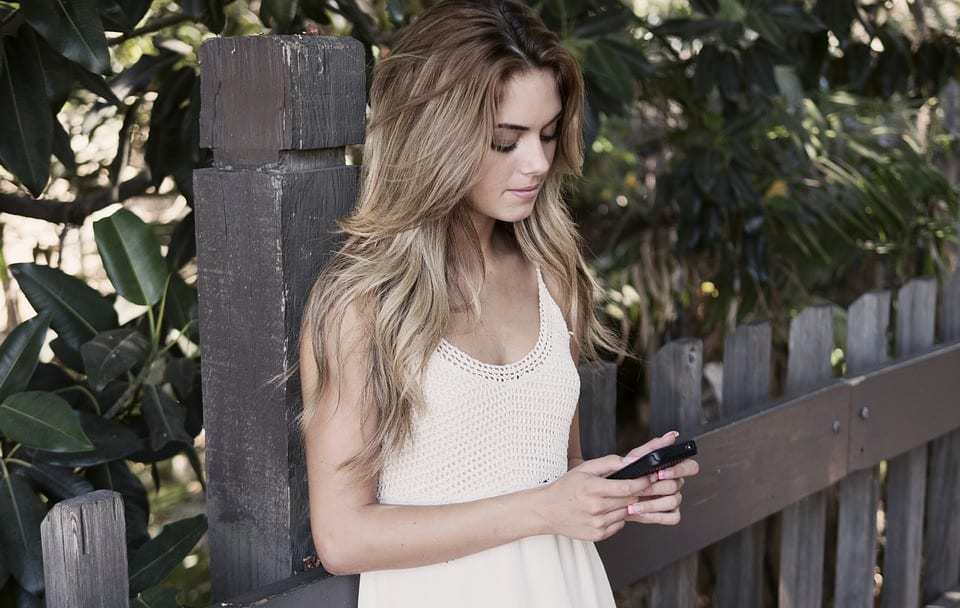 FameGame App - Teen using smartphone