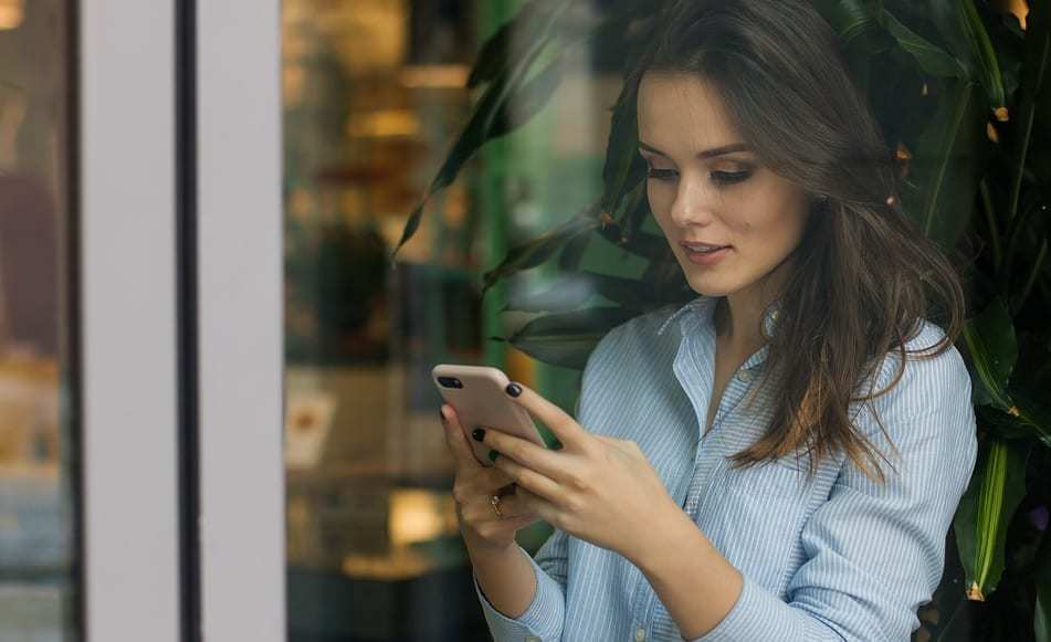 location-based searches - Woman using mobile phone