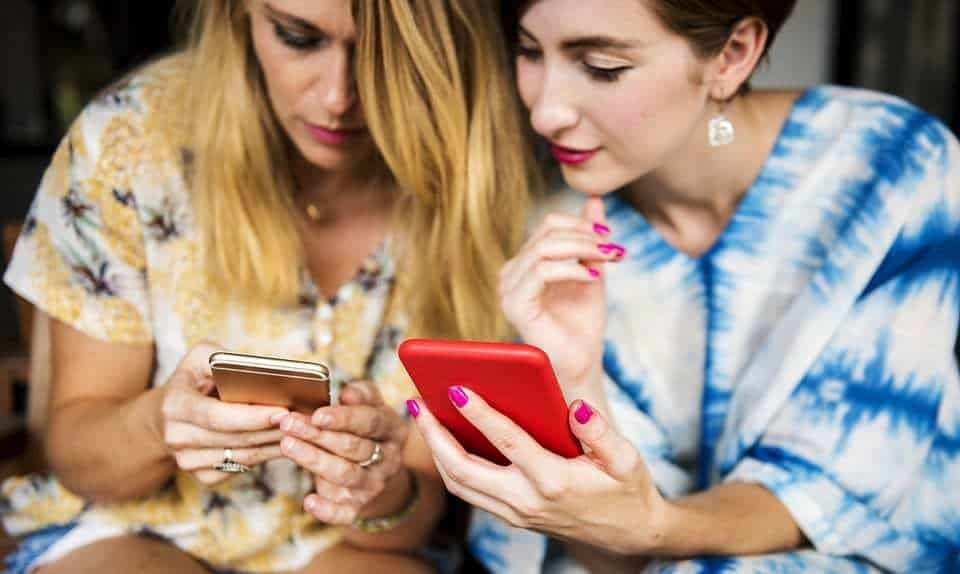 mobile game spenders - women using smartphones