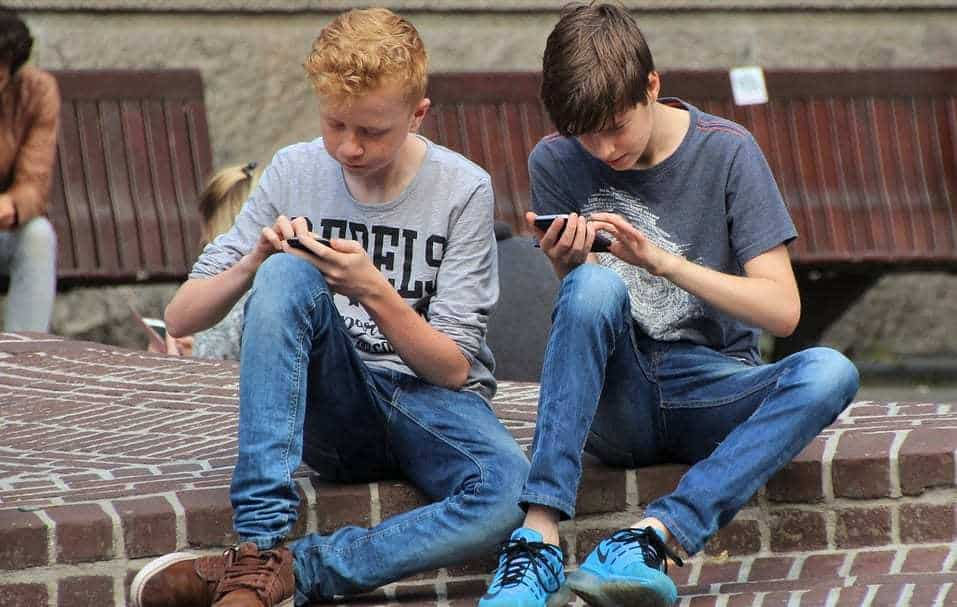 mobile phone ban - boys using cell phones