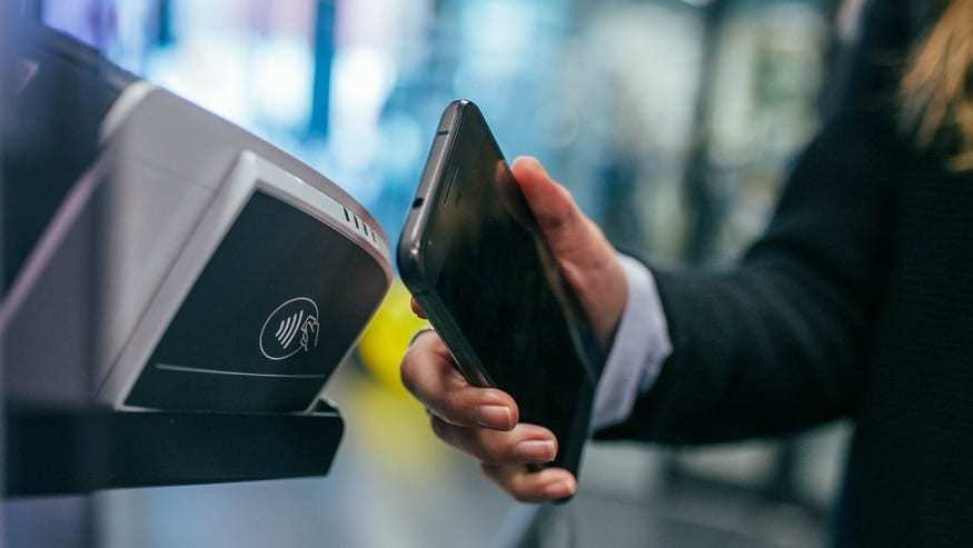 NFC payments - woman with Android phone