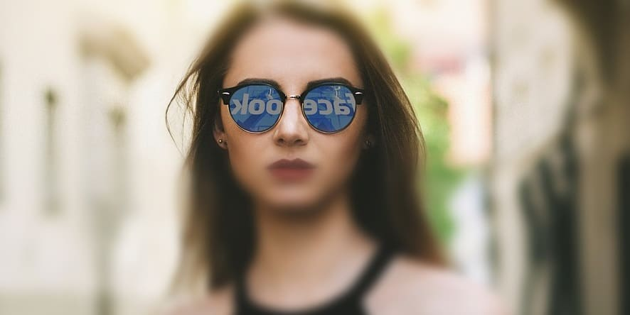 Facebook AR Glasses - Woman wearing sunglasses - facebook logo reflection