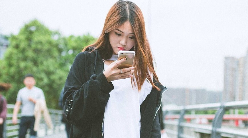 Facial recognition payments - Woman with mobile phone