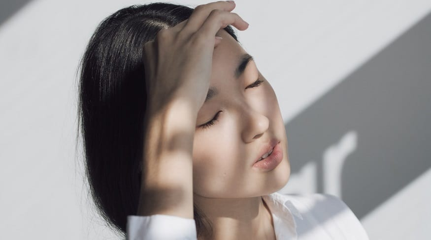 Migraine health app - Woman with headache