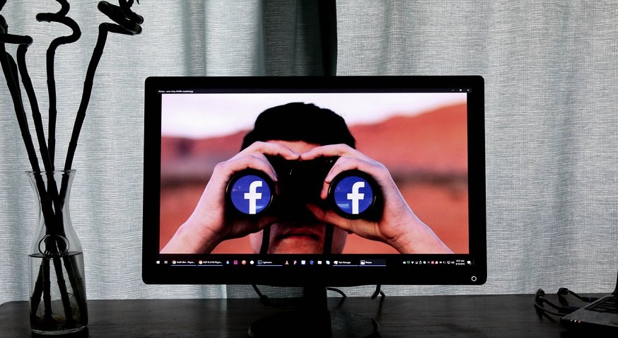 Facebook facial recognition - Man with binoculars - facebook logo