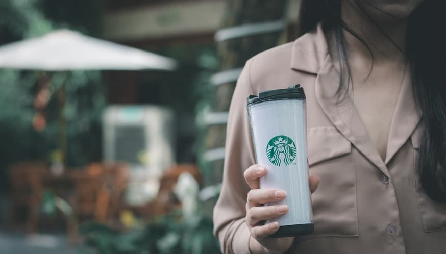 Starbucks Payment Pen - Woman holding Starbucks Coffee