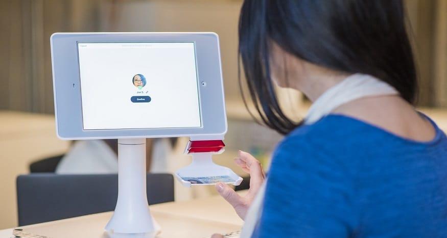 QR code use - woman looking at monitor