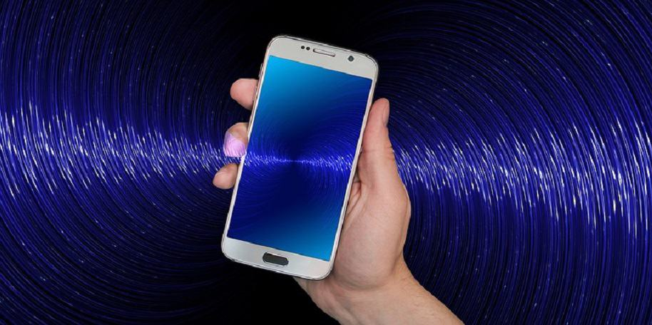 Contact tracing technology - person holding phone in blue background