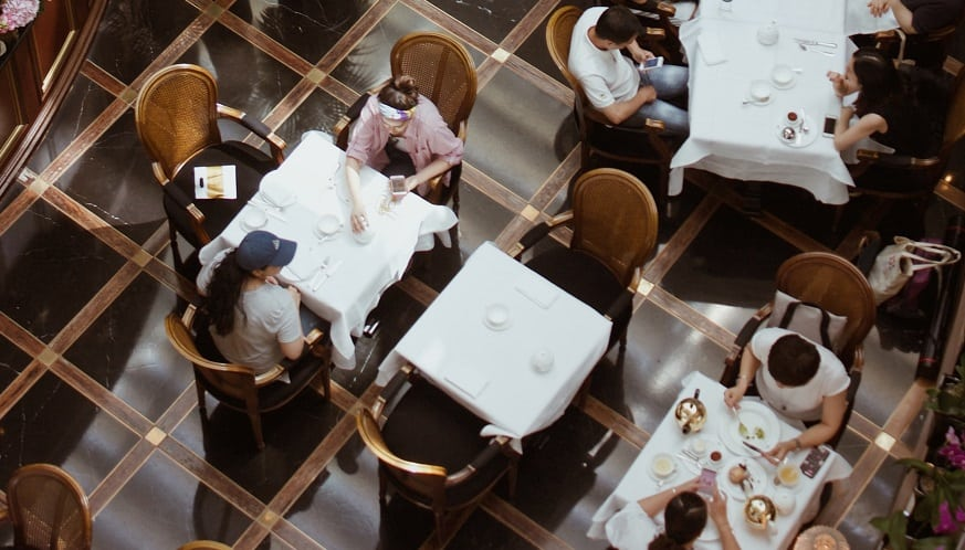 Restaurant QR codes - People sitting at tables inside restaurant