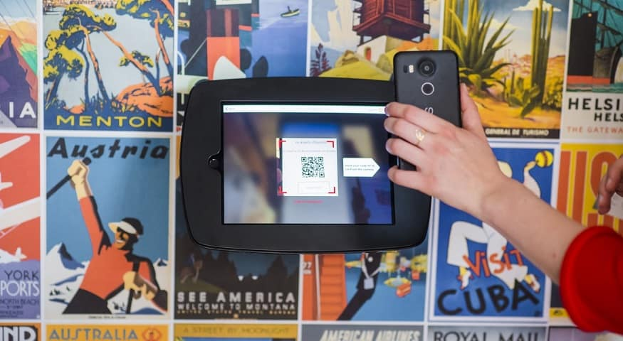 Use of QR Codes - person scanning QR code with mobile phone