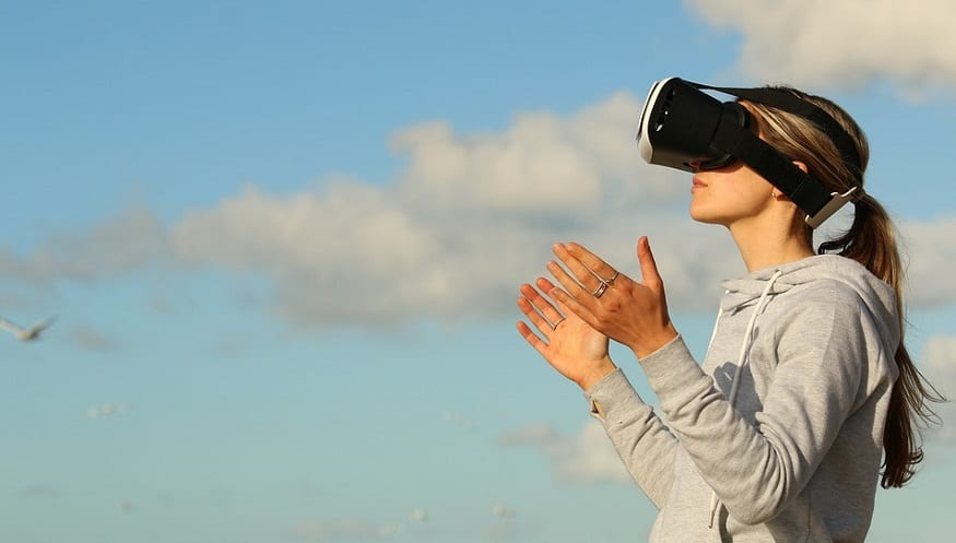 Virtual Reality nature - person wearing VR headset outside