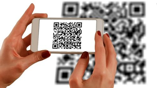 QR code generator - person scanning barcode