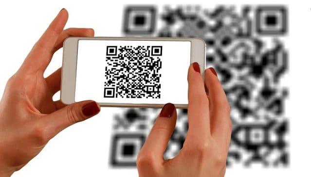 QR code generator - person scanning barcode