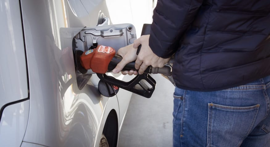 Gas Station Mobile Payments - person refuelling car