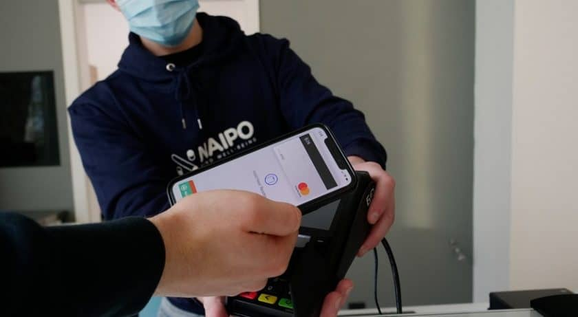 Mobile payments adoption - person paying with mobile phone