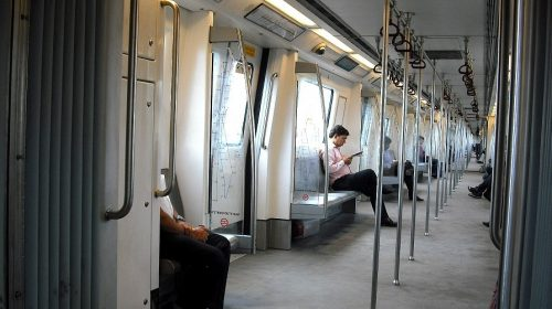 QR Code ticketing system - Passengers riding Delhi Metro train