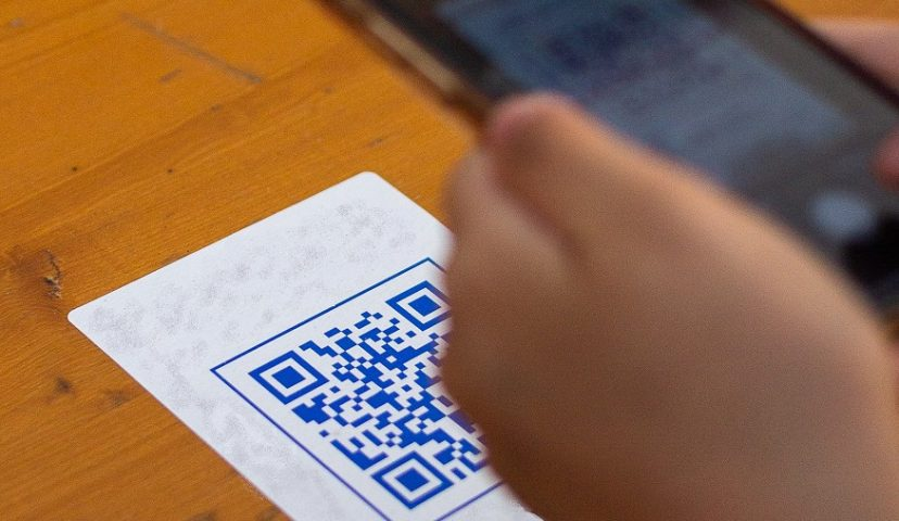 Contactless QR codes - Person scanning QR code with smartphone