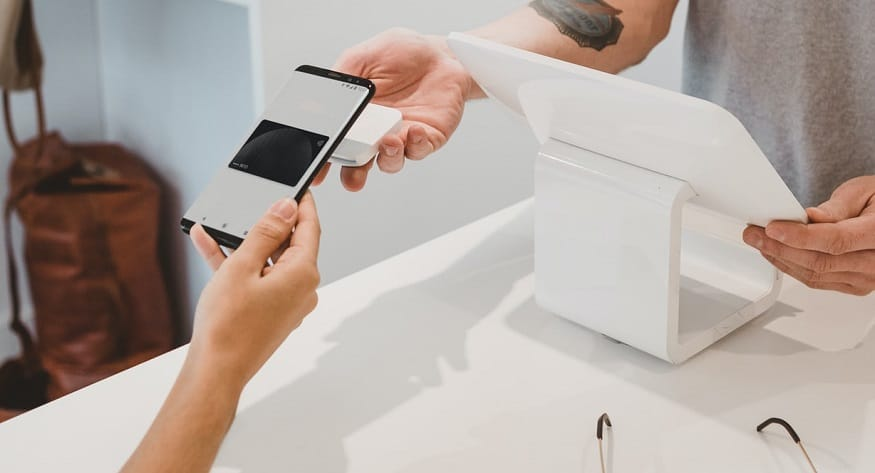 Figure Pay - person using mobile wallet to may payment