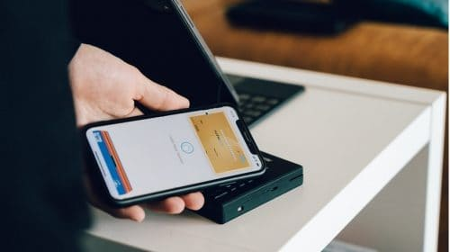 Mobile payment apps - person paying with mobile phone