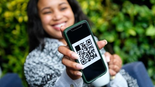 QR code campaign - person displaying QR code on phone