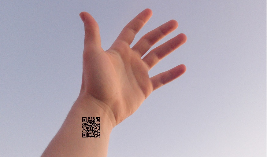 QR code tattoos - Image of hand with a QR code on wrist