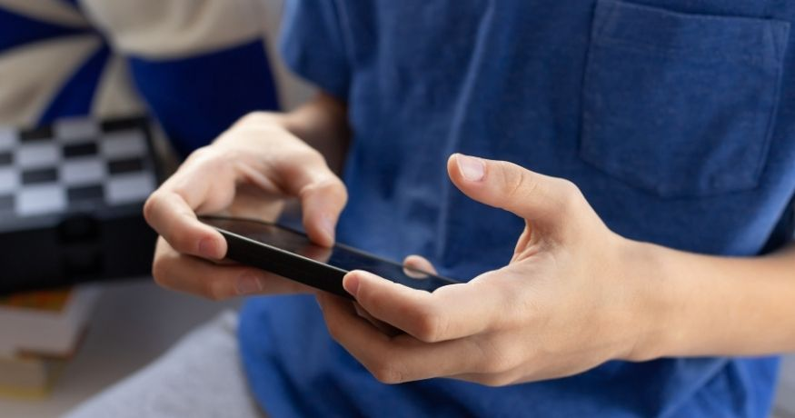 Gaming addiction - child using mobile phone