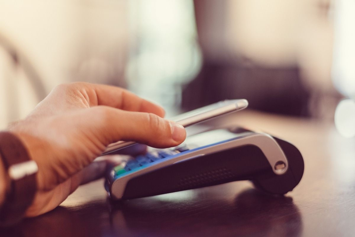 Mobile payment app - person using mobile wallet