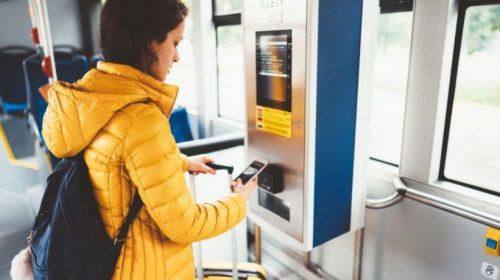 NFC ticketing - Person using phone on public transit