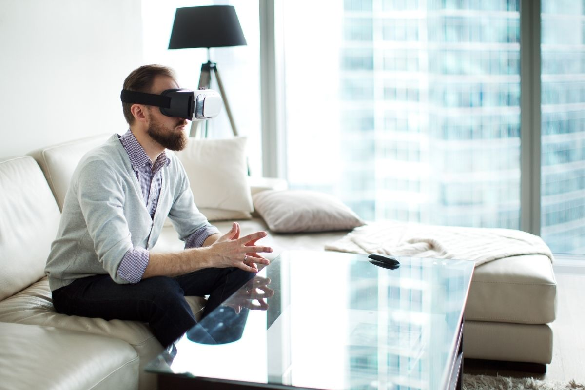 Virtual reality remote work - person sitting wearing VR headset