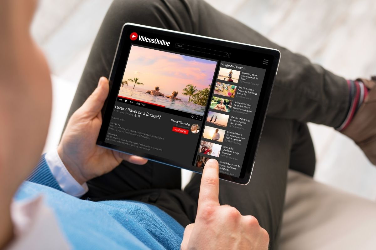 YouTube Mobile App - Person using YouTube on tablet